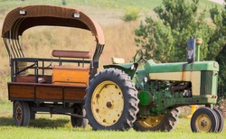 Old tractor with covered wagon