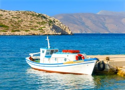 Old traditional beautiful fishing boat by the sea in Amorgos island in Greece