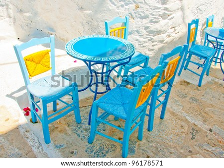 Old traditional beautiful iron made round shaped small coffee table and chairs out of a cafe in Chora the capital of Amorgos island in Greece