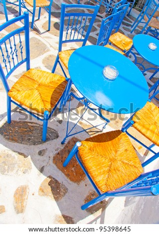 Old traditional beautiful iron made round shaped small coffee tables and chairs out of a cafe in Chora the capital of Amorgos island in Greece