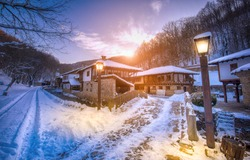 Old traditional Bulgarian house in Architectural Ethnographic Complex Etar (Etara) near town of Gabrovo , Bulgaria. Open Air Museum at winter time with a snow at sunset. History tourism