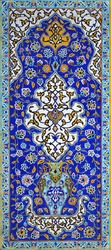 Old, traditional ceramic tiles, pattern of flowers and ornaments, vaulting on the wall in the Golestan Palace complex in Tehran, Iran