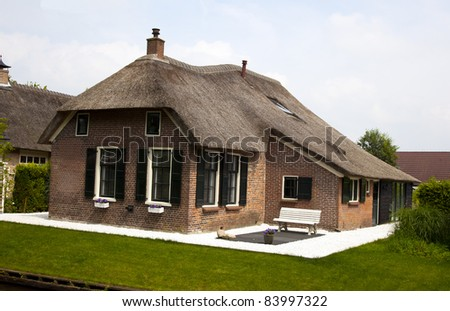 Old traditional dutch house in giethoorn stock photo for Classic dutch house of 60m2