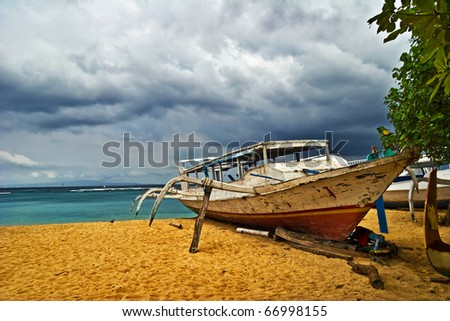 Old traditional fishing boats at the beach. Bali, Indonesia