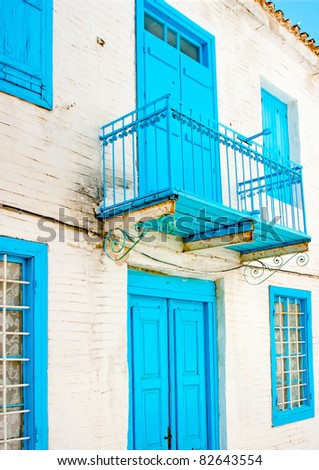 Old traditional  house with blue doors  and windows in Skiathos Greece