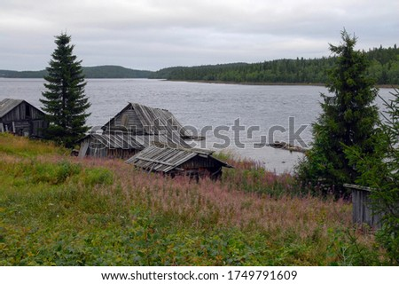 Old traditional Keret village on the bank of Keret river. Republic of Karelia, Russia. Stock fotó ©