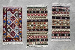 Old traditional romanian wool carpets with ancient motifs
