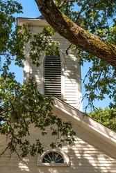 Old Traditional Rural Church Steeple, Tree Branches and Shadows.