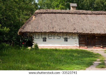 Old traditional ukrainian house with thatched roof