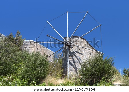Old traditional windmill at Lasithi plateau of Crete island in Greece