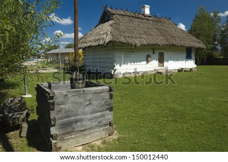 Old, traditional wooden cottage house in a village in Bialowieza, Poland
