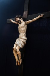 Old traditional wooden crucifix. Jesus Christ sculpture.