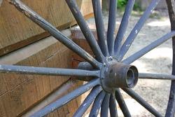Old traditional wooden spoke wheel.