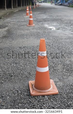 Old Traffic road cone pylon, road cone on the asphalt