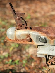 Old trailer hitch covered in rust