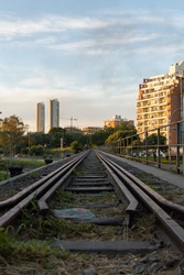 old trailway with buildings in the back at sunset