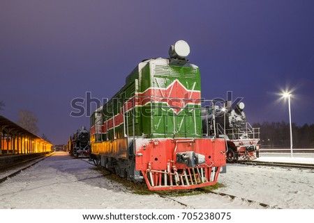 Old train at vintage station. Winter time.