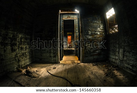 Old train carriage interior with light intruding