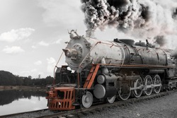 Old train on lake, transportation and history