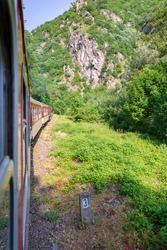 Old train traveling through the mountains