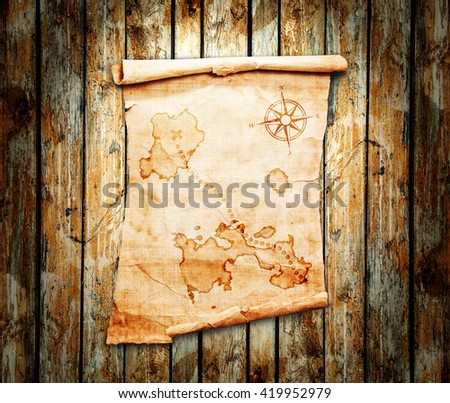 Old Treasure Map On A Wooden Grunge Background 419952979