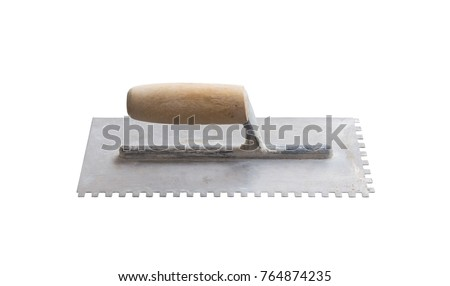 old trowel comb isolated on white background with clipping path