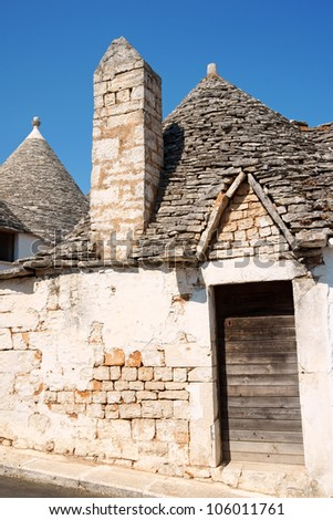Old Trulli houses in Alberobello, Apulia, Italy. Alberobello was founded in the 15th century on land that was originally an oak forest in the province of Bari.