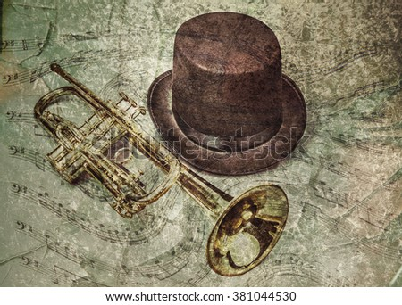 old trumpet and hat with a...