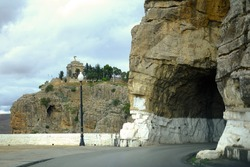 Old tunnel along le Boulevard de l'Abime located in the medina of Constantine, Algeria in autumn season with the background of Monument aux Morts (Monument to the Fallen) in Constantine, Algeria.