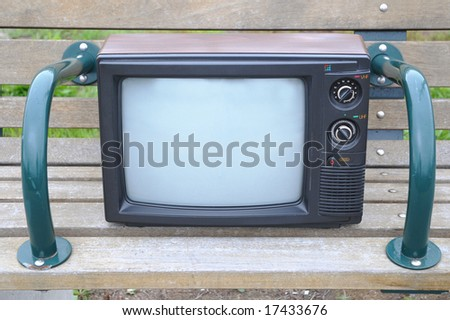Old TV on a bench