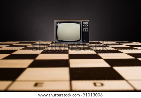 Old TV on the chessboard.