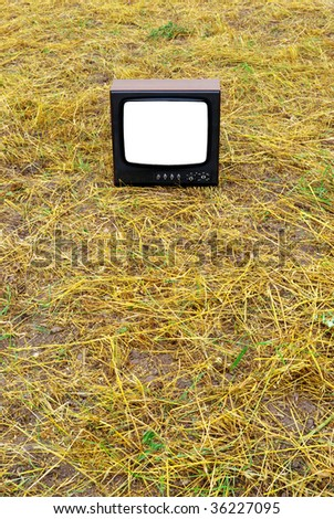 Old tv on the meadow. Element of design.