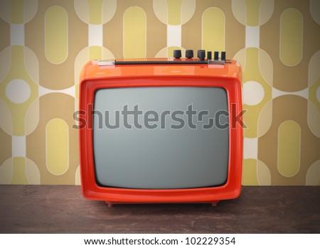 Old TV on vintage background
