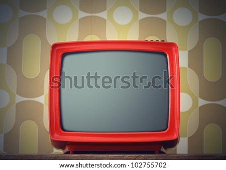 Old TV on vintage background