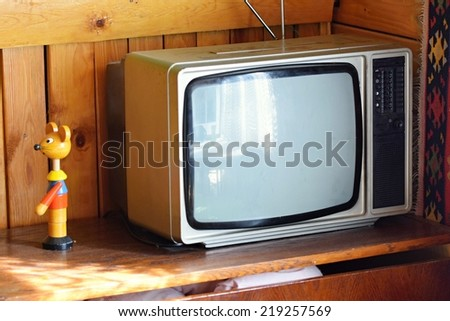 Old  tv. Retro style. Old household wooden background