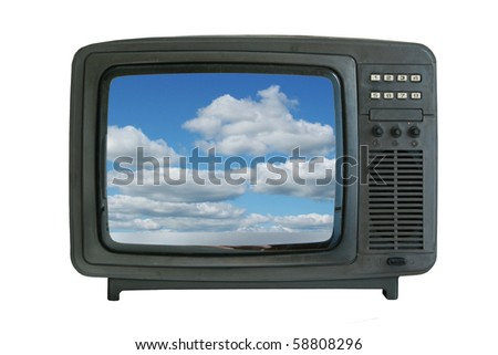 old tv-set showing blue sky with clouds