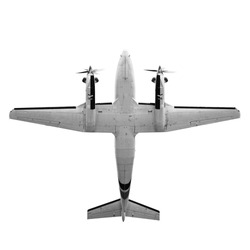 Old twin prop gray cargo plane isolated on white background. Bottom view
