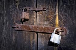 Old two rusty locks on wooden door