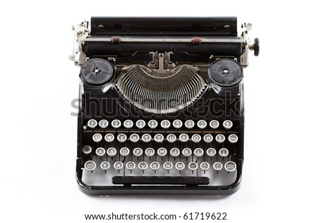 Old typewriter isolated on white
