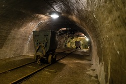 Old underground mine with equipment and rails, Banska Stiavnica, Slovakia