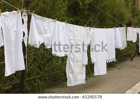 old underwear hanging out to dry - hang out the washing - clothes-line with ancient linen