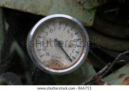 Old unit rate counter on a derelict piece of farm machinery.  Has x100 scale markings. - stock photo