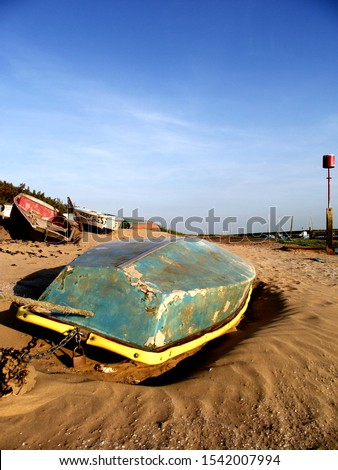 Old upturned boat on a beach