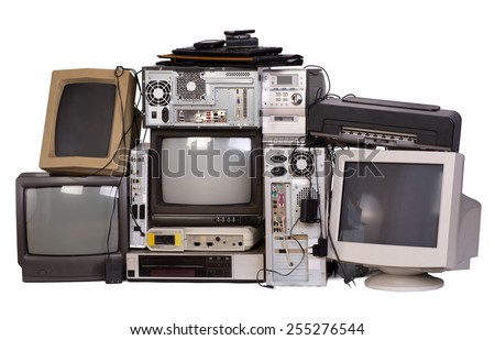 Old, used and obsolete electronic equipment isolated on white stock photo