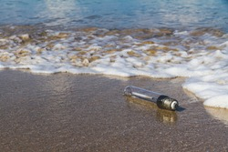 Old used bulbs are left on the beach, Nature and environment pollution campaign concept. Environmental pollution. Ecological problem.