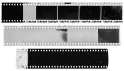 Old, used, dusty and scratched black and white celluloid film strips isolated on white background