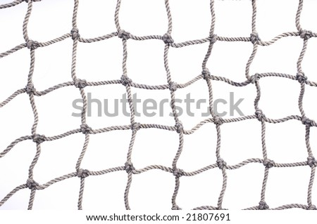 Old used fishing net with lots of loose hemp fibers left intact. On a white background.