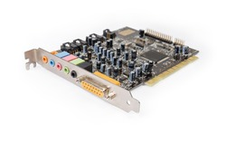 Old used internal sound card for PCI bus used in desktop computers on a white background, close-up in selective focus