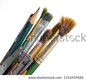 Old used paintbrushes.Used dirty paint brushes on white background