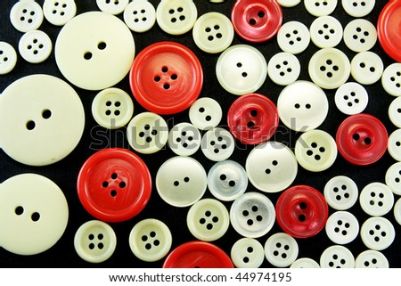 Old used Sewing buttons isolated on black